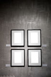 Empty frames on the plaster wall Royalty Free Stock Photo