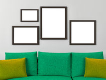 Empty frames in a room with a sofa Stock Image