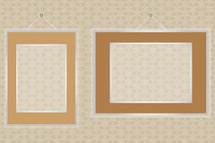 Empty frames on wall with seamless decor. Empty retro frames on a wall with seamless floral design stock illustration