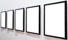 Empty frames on white wall Stock Photo