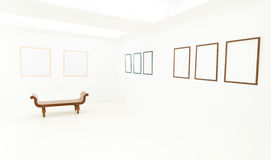 Empty frames and wooden bench in white room Stock Photos