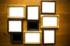 Empty frames on wooden  wall Royalty Free Stock Photos