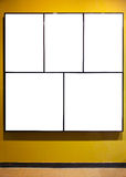 Empty frames on yeellow wall in gallery room Royalty Free Stock Photos