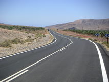 Empty freeway. Empty highway in the mountains, Fuerteventura, Canary islands Stock Photography