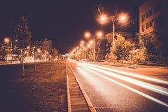 Empty freeway road at night.  stock photos