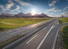 Empty Freeway Through Vastness At Idyllic Sunrise Royalty Free Stock Photo