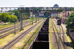 Empty freight train wagons stand on rails Stock Image