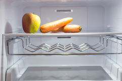 Empty fridge diet. On this picture you can see empty fridge. This picture shows that the best diet to loose weight is to have empty fridge royalty free stock photography