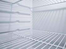 Empty fridge from inside. View between the fridge shelves Royalty Free Stock Photography