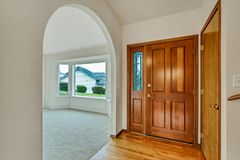 Empty front entrance door with office room with large windows and arches royalty free stock photography