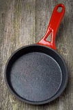 Empty frying pan on a wooden background (and space for text) Royalty Free Stock Images