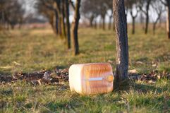 Empty fuel canister. Abandoned on a field Royalty Free Stock Photo