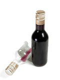 Empty and Full. Two single serving bottles of dark red wine, one empty, one full Royalty Free Stock Images
