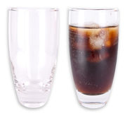Empty and full glass. Two glasses isolated on white background. One is empty an one is filled with cola and ice royalty free stock photography