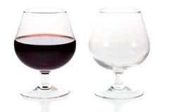 An empty and a full glass of red wine Stock Photo