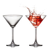 Empty and full martini glass with red cocktail. With splash isolated on white Royalty Free Stock Photography