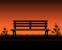 Empty Garden bench. Empty wooden Bench, Sunset time Stock Photos