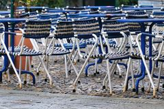 Empty garden chairs in outside garden. Empty chairs in outdoor cafe outside garden Stock Photo