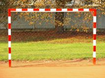 Empty gate. Outdoor football or handball playground, light red crushed bricks surface on ground Stock Images