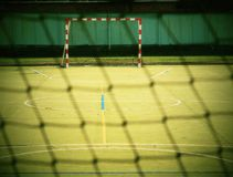 Empty gate. Outdoor football or handball playground, plastic light green surface on ground Stock Photo