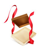 Empty gift box with red ribbon falling Royalty Free Stock Photography