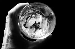 Empty glass of Alcohol with ice. Empty cocktail glass hints at additction by alcoholic. No more alcohol to drink stock photo