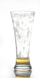 Empty glass of beer. An empty glass of beer isolated on whit with small reflection Stock Photo