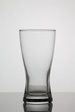 Empty glass of beer on white background stock photography