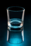 Empty glass on black background illuminated Royalty Free Stock Photos