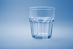 Empty glass. On a blue background Stock Image