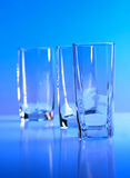 Empty glass on blue background Royalty Free Stock Photography