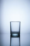 Empty glass on blue light background. Object Stock Photography