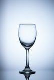 Empty glass on blue light background Stock Image