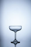 Empty glass on blue light background Royalty Free Stock Photography
