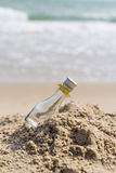 Empty glass bottle. On the beach Royalty Free Stock Image