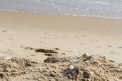 Empty glass bottle on the beach. With copy space Royalty Free Stock Images