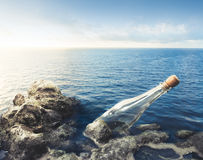 Empty glass bottle at sea Stock Photo