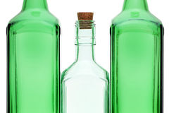 Empty glass bottle with stopper Stock Photos