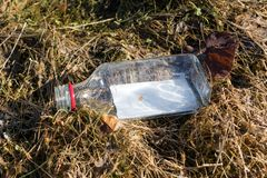 Empty glass bottle thrown on the ground. royalty free stock photography