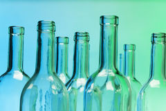 Empty glass bottles with close-up focus to necks Stock Photography