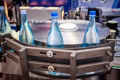 Empty glass bottles on the conveyor royalty free stock photos