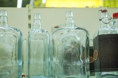 Empty glass bottles in factory to fill with drink royalty free stock image