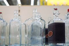 Empty glass bottles in factory to fill with drink royalty free stock photo