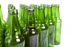 Empty glass bottles and one full Stock Images