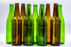 Empty glass bottles on a white background stock photo