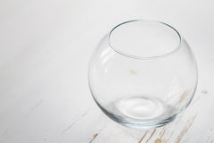 Empty glass bowl on white wood background Royalty Free Stock Photography