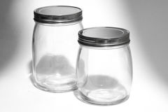 Empty glass canister in white background Stock Photography