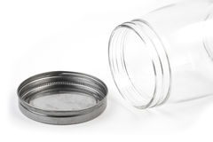 Empty glass canister in white background Royalty Free Stock Photography