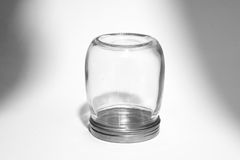Empty glass canister in white background Royalty Free Stock Images