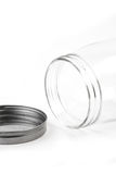 Empty glass canister in white background Stock Photos